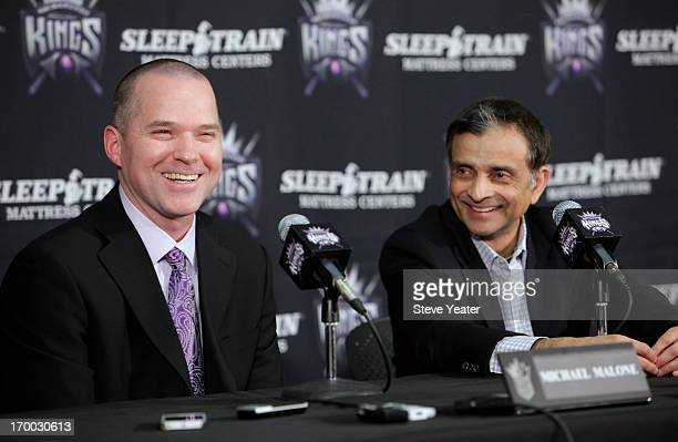 Sacramento Kings owner Vivek Ranadive right introduces new head coach Michael Malone during a news conference at Sleep Train Arena on Monday June 3...