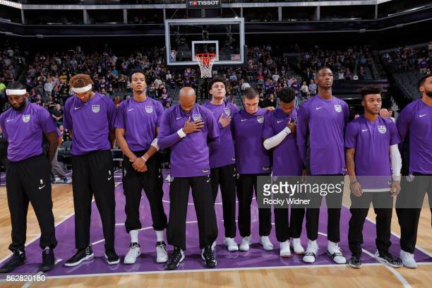 Sacramento Kings players line up for the national anthem of the game against the San Antonio Spurs at Golden 1 Center on October 2 2017 in Sacramento...