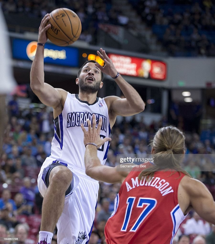 Sacramento Kings point guard Greivis Vasquez (10) goes to the basket against Los Angeles Clippers power forward Lou Amundson (17) in their preseason game on Monday, October 14, 2013, at Sleep Train Arena in Sacramento, California.