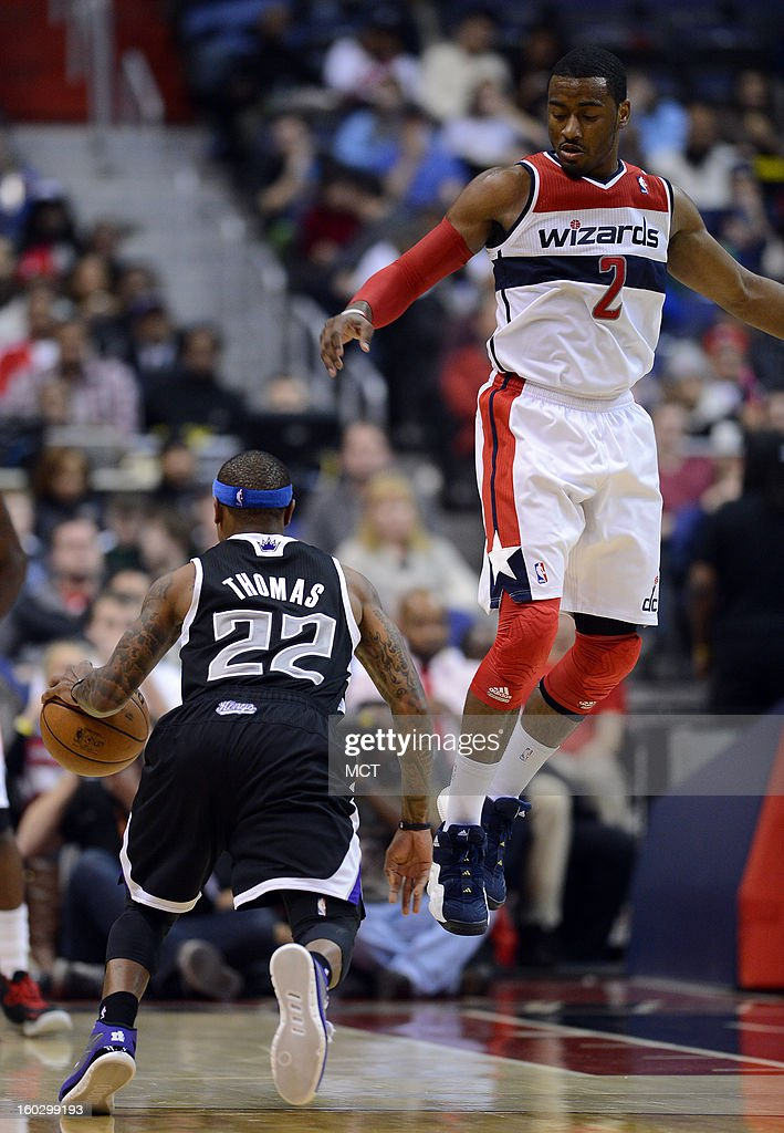 Sacramento Kings point guard Isaiah Thomas (22) dribbles past Washington Wizards point guard John Wall (2), as Wall goes up in the air on defense, in the third quarter at the Verizon Center in Washington, D.C., Monday, January 28, 2013. The Kings beat the Wizards, 96-94.
