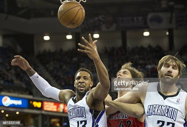Sacramento Kings power forward Derrick Williams looks for a foul call as he scores a basket against the Portland Trail Blazers center Robin Lopez at...