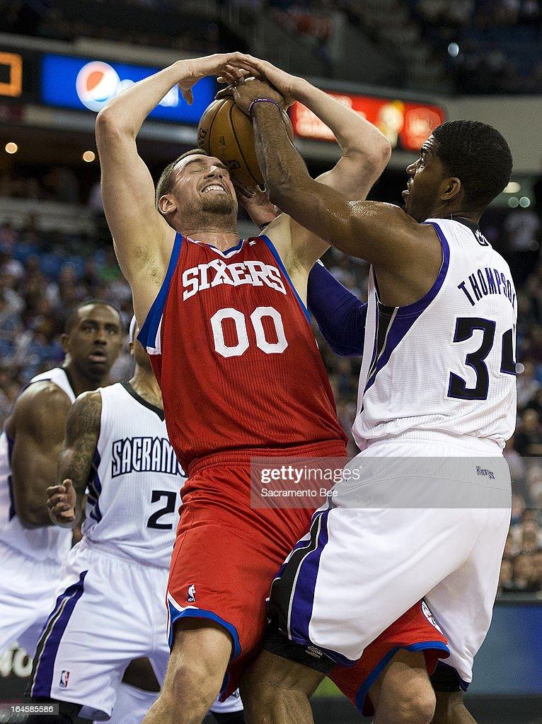 Sacramento Kings power forward Jason Thompson (34) and Philadelphia 76ers center Spencer Hawes (00) battle for rebound in an NBA basketball game at Sleep Train Arena in Sacramento, California, Sunday, March 24, 2013.