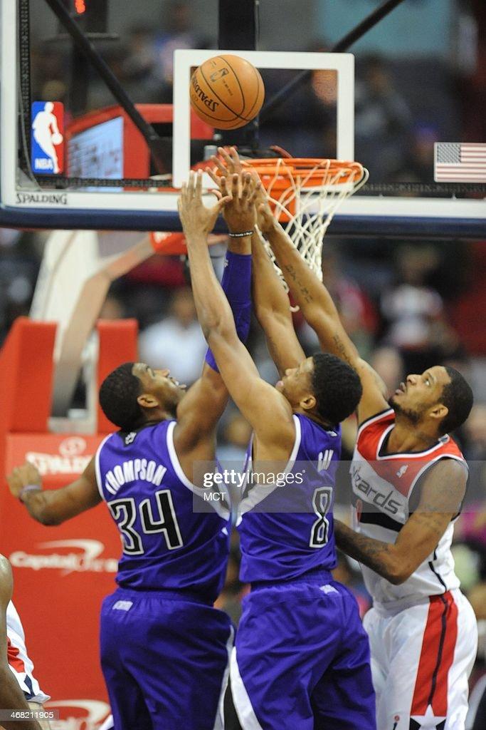 Sacramento Kings power forward Jason Thompson Sacramento Kings small forward Rudy Gay and Washington Wizards small forward Trevor Ariza fight for a...