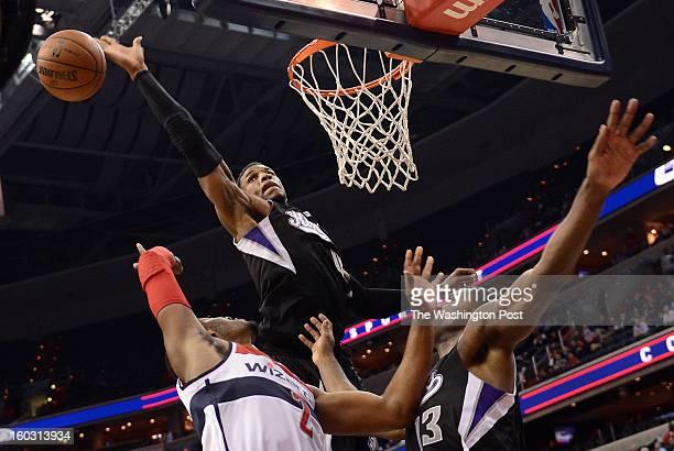 Sacramento Kings power forward Thomas Robinson blocks the shot by Washington Wizards point guard John Wall bottom left during the final minutes of...