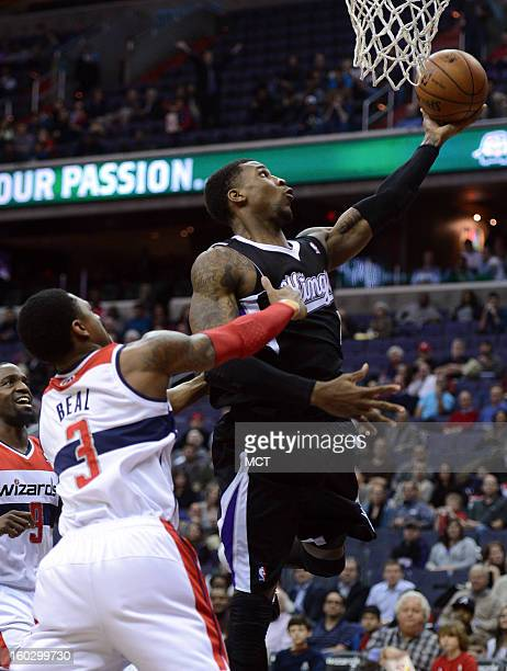 Sacramento Kings power forward Thomas Robinson gets fouled by Washington Wizards shooting guard Bradley Beal on a drive to the basket in the first...