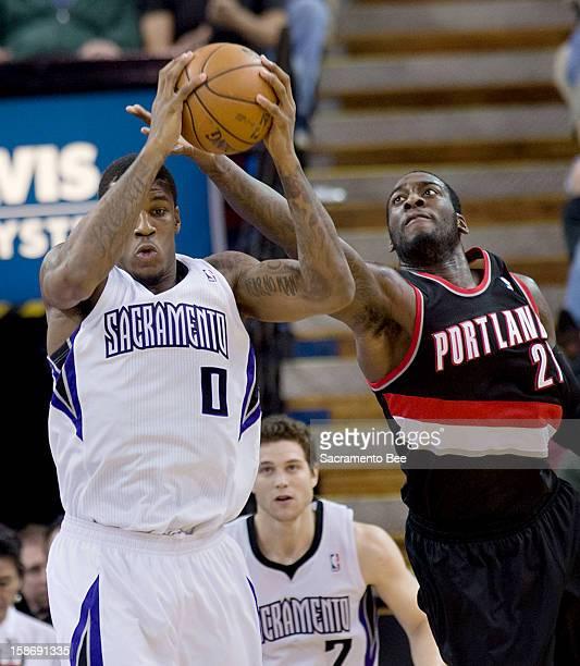 Sacramento Kings power forward Thomas Robinson pulls down a rebound against Portland Trail Blazers center JJ Hickson during an NBA game at Sleep...