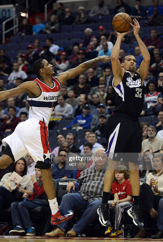 Sacramento Kings shooting guard Francisco Garcia (32) hits a three-pointer against Washington Wizards small forward Trevor Ariza (1) in the first quarter at the Verizon Center in Washington, D.C., Monday, January 28, 2013.