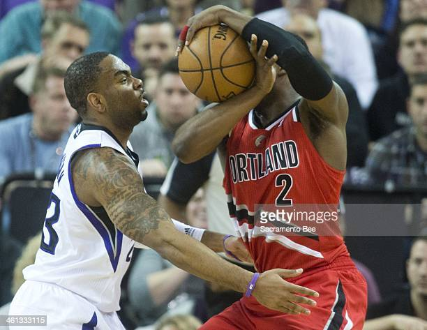 Sacramento Kings shooting guard Marcus Thornton fouls Portland Trail Blazers shooting guard Wesley Matthews at Sleep Train Arena in Sacramento Calif...