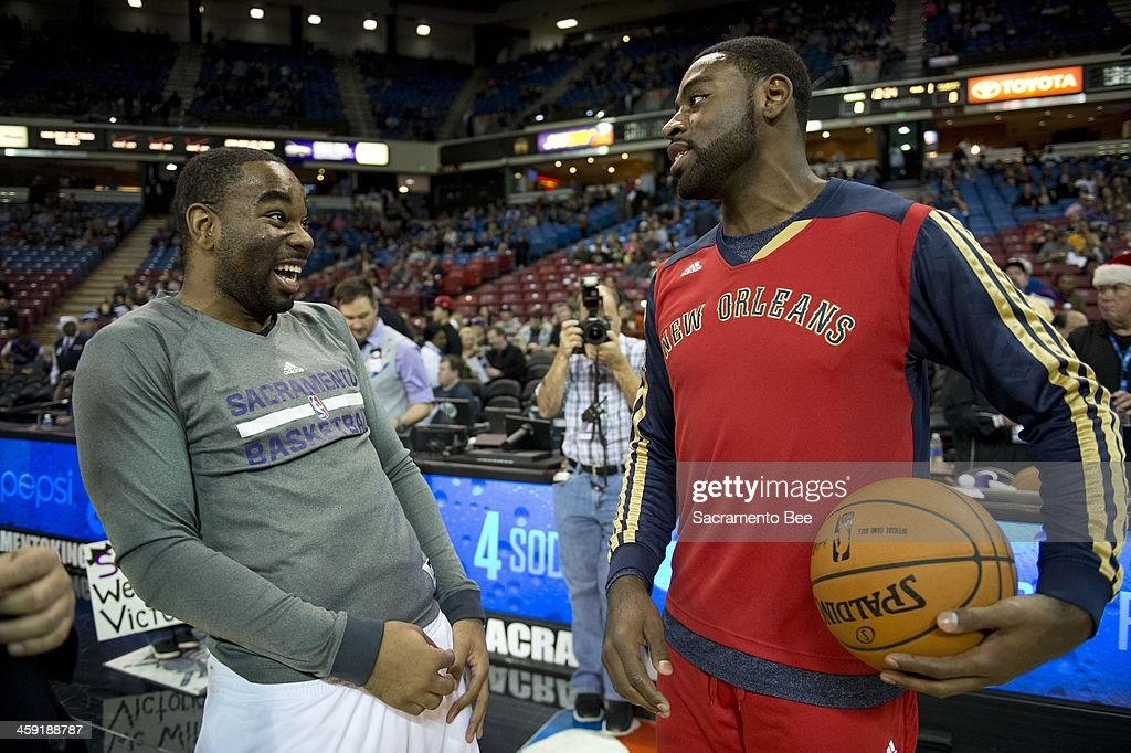 Sacramento Kings shooting guard Marcus Thornton (23) shares a laugh with former teammate New Orleans Pelicans point guard Tyreke Evans (1) before the game at Sleep Train Arena in Sacramento, Calif., Monday, Dec. 23, 2013.