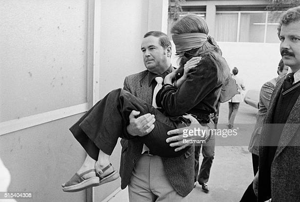 Lynette Fromme is carried into the federal courthouse by a US marshal for the second day in a row where she again refused to participate in her trial...