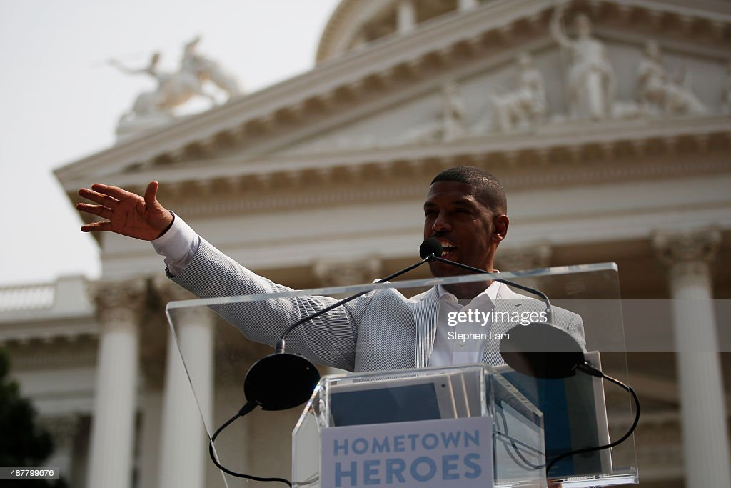 Sacramento Mayor Kevin Johnson speaks on stage during a parade honoring Alek Skarlatos Anthony Sadler and Spencer Stone for their August 21 actions...