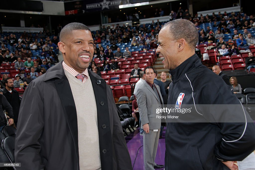 Sacramento mayor Kevin Johnson talks to a referree prior to the game between the Houston Rockets and Sacramento Kings on December 11 2014 at Sleep...