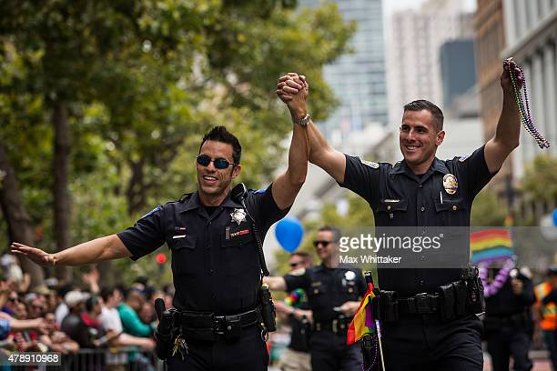 Sacramento Police Officer Jeff Kuhlmann left marches with his boyfriend Los Angeles Police Officer David Ayala right in the San Francisco Gay Pride...