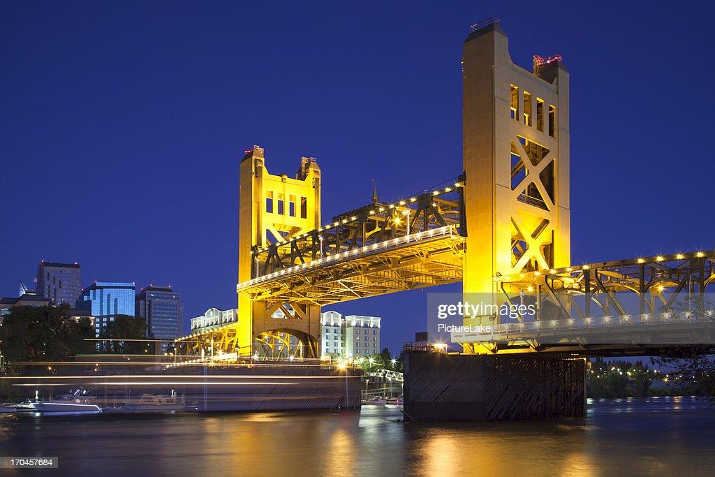 Sacramento River and Tower Bridge raised, at dusk