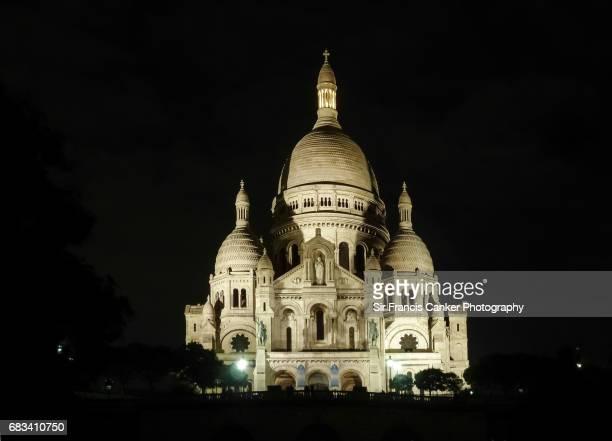 Sacre Coeur Basilica in illuminated at night in Montmartre, Paris