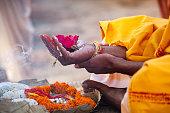 Varanasi, India - December 16, 2015 : Sacred flowers are taken for worship on hand at river Ganges, varanasi, uttar pradesh, india.