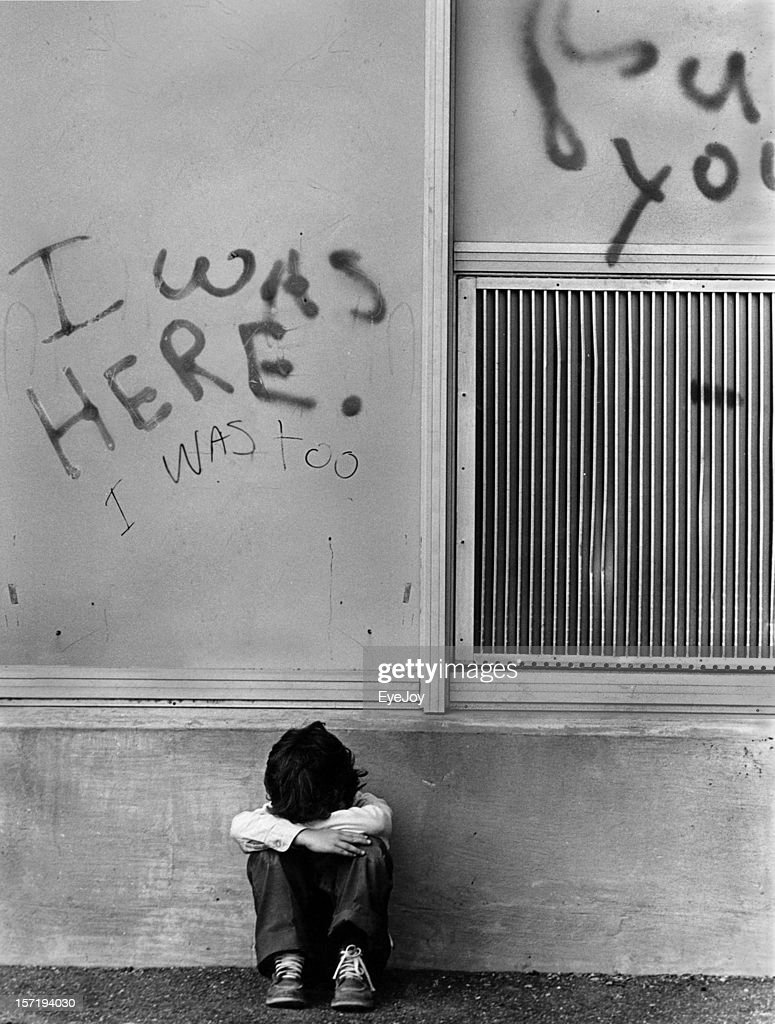 Sad Abused Child Crying Under I Was Here Graffiti Sign ...