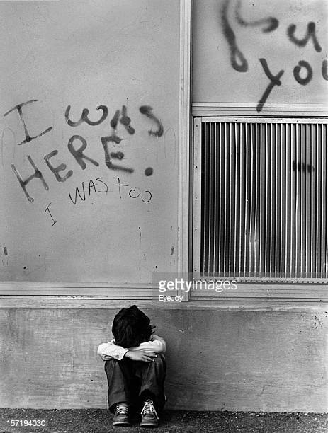 Sad Abused Child Crying Under I Was Here Graffiti Sign