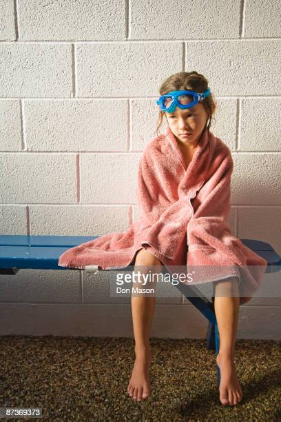 Sad Asian girl in towel and goggles