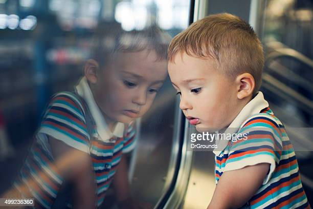 Sad boy traveling on subway train