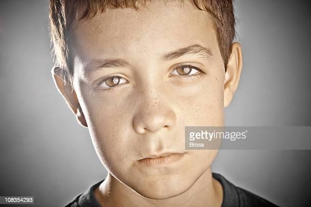 Sad boy with staring eyes
