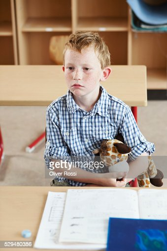 Sad boy with stuffed animal : Foto de stock