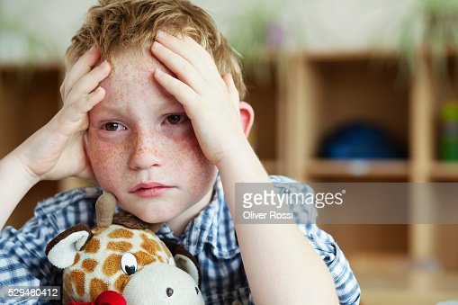 Sad boy with stuffed animal : Stock Photo