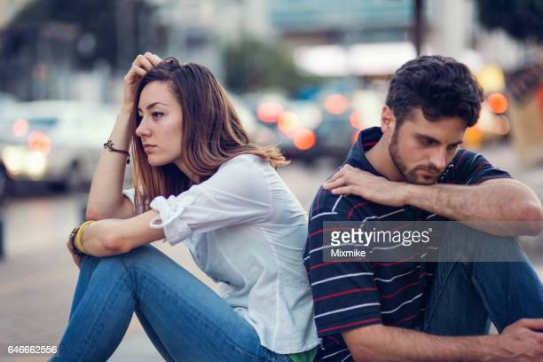 Sad couple leaning on