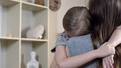 Sad daughter tightly hugging her mother telling about her problems, mother love, stock footage