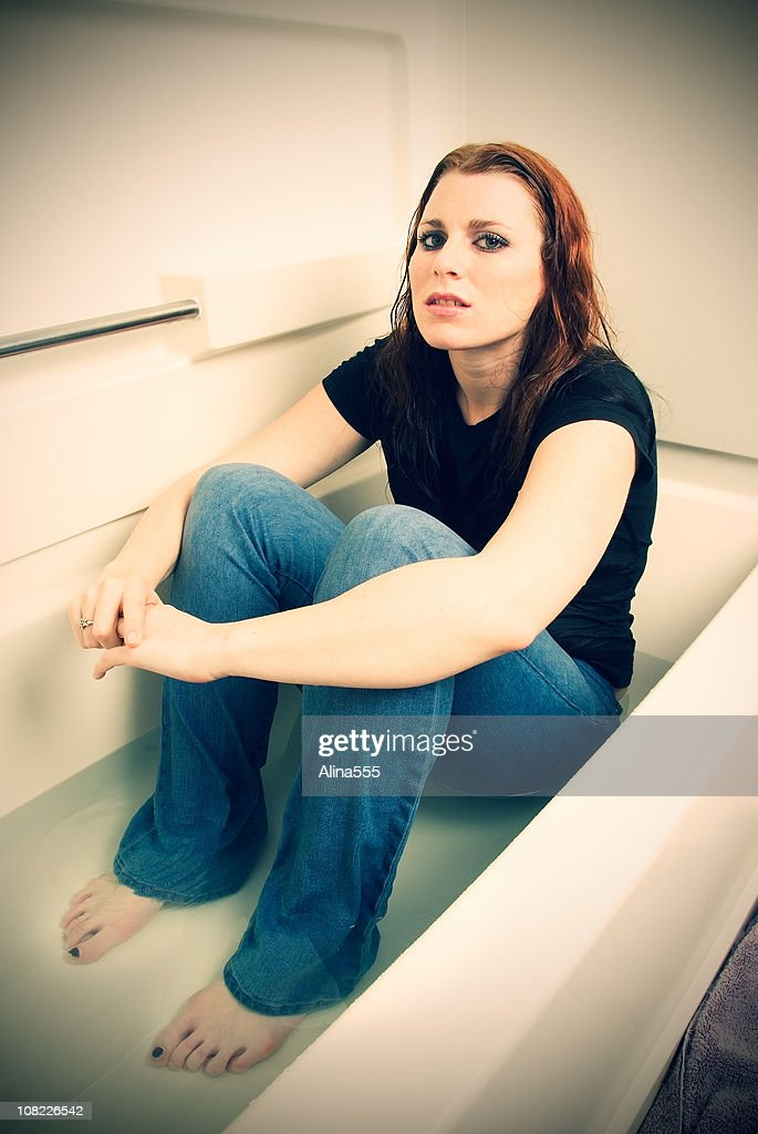 Young Woman Enjoys The Bubble-Bath In The Bathtub. Stock