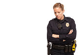 Sad female police officer with arms crossed