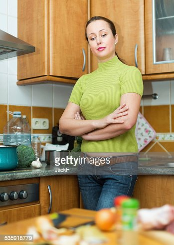 Sad female tired to cook : Stock Photo
