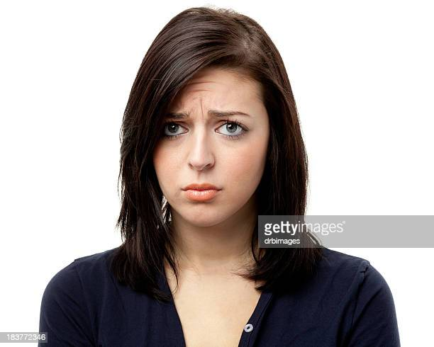 Sad Frowning Young Woman Looking At Camera