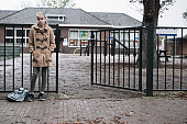 Schoolgirl at school outside sad and alone. Concept of bullying or insecurity