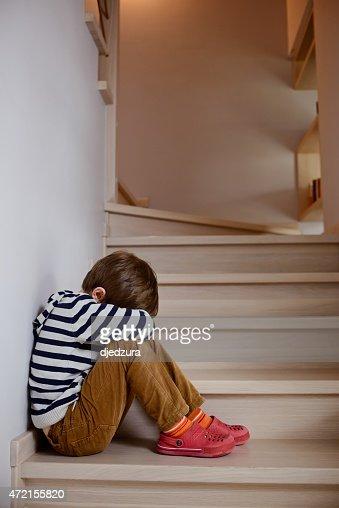 Sad little boy crying depressed sitting : Stock Photo