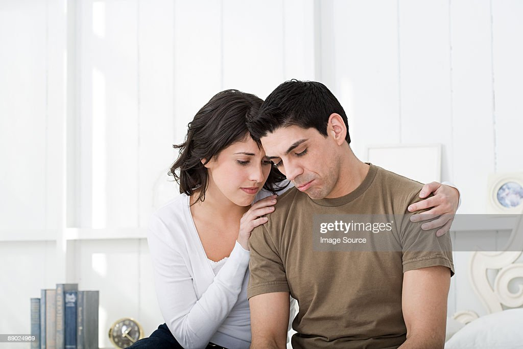 Sad looking hispanic couple
