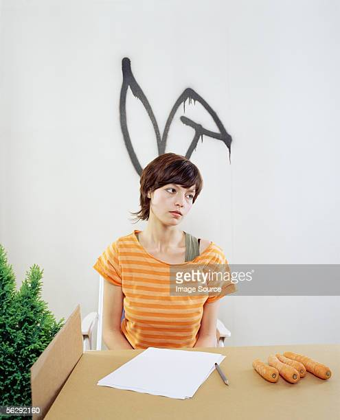 Sad looking woman dressed as a rabbit