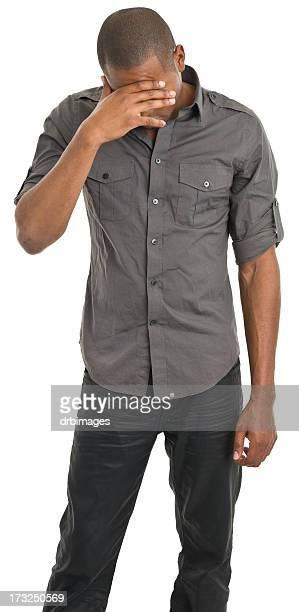 Sad Man Covers Face With Hand