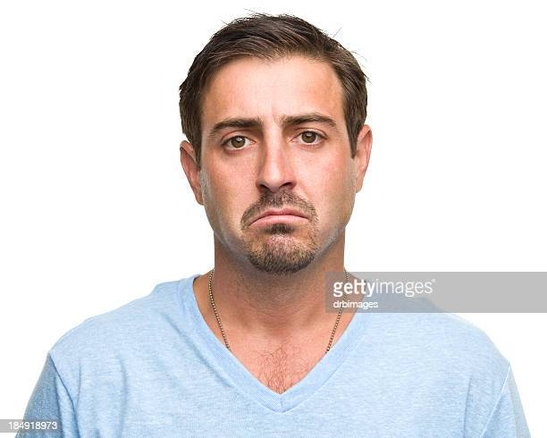 Sad man in a light blue T-shirt on a white background