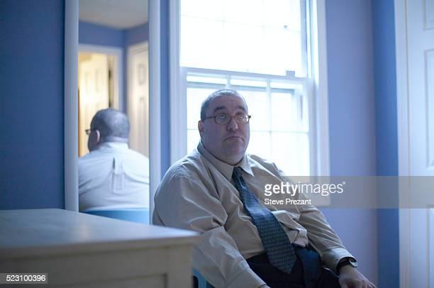 Sad Man Sitting in Room