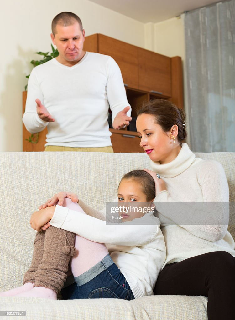 Sad mother comforting daughter : Stock Photo