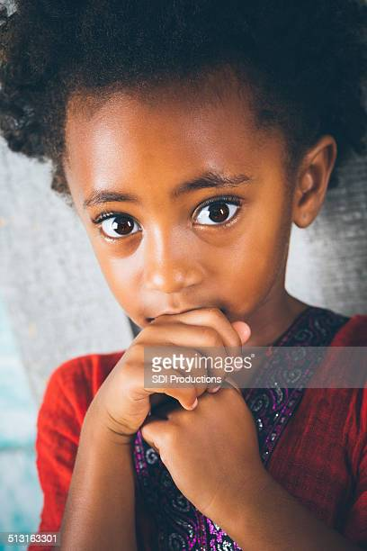 Sad or scared Ethiopian child with big brown eyes