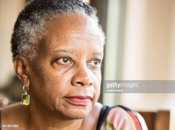 Sad senior african american woman
