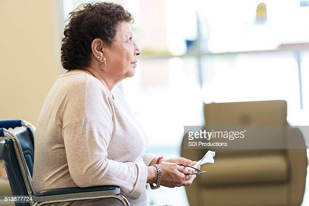Sad senior woman in assisted living facility
