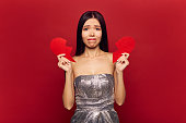 Sad single girl with big broken heart. Valentine's day and love concept, divorce