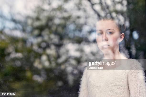 Sad Teenager by Window