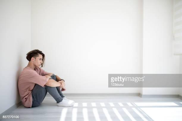 Sad Teenager Sitting Blank Room