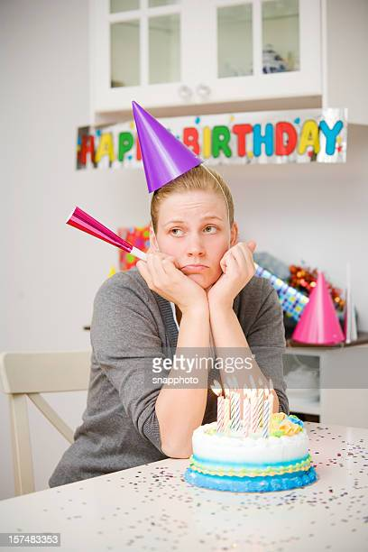 Sad Woman Birthday Party with Cake and Candles