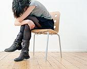 Sad woman on chair