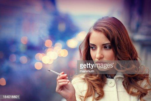 sad woman smonking cigarette on the balcony : Stock Photo